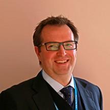 Dr Ynyr Hughes-Roberts